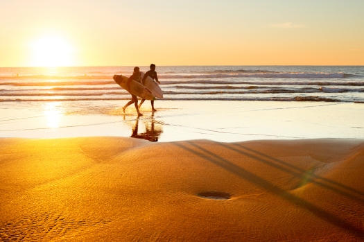 bigstock-Surfers-At-Sunset-Portugal-80722958.jpg
