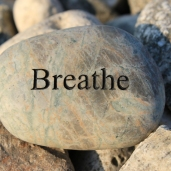 Positive reinforcement word Breathe engrained in a rock
